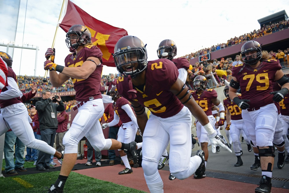 The Gophers take the field at TCF Bank Stadium on Oct. 8, 2016.