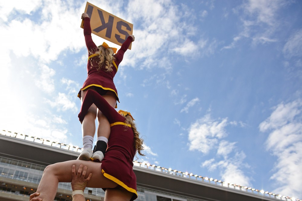 The Gophers cheer team rouses the crowd at TCF Bank Stadium on Oct. 8, 2016.