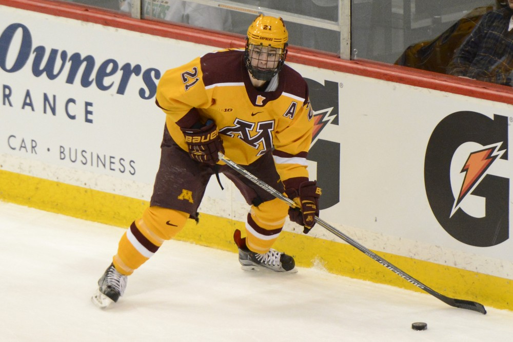 Gophers forward Connor Reilly handles the puck while playing against Michigan State in the Xcel Energy Center on Mar. 19, 2016.