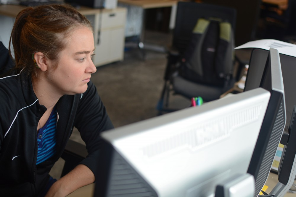First year Psychology Ph.D student Erin O'Neill works at her office in Elliott Hall on Tuesday, Oct. 11, 2016 on East Bank. O'Neill herself has two cochlear implants and she also conducted research about cochlear implants for the University of Minnesota's Center for Applied and Translation Sensory Science, which will be released later this month.