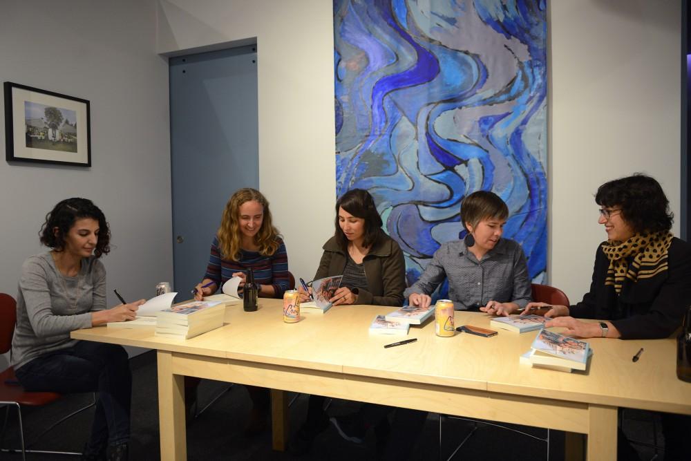 Authors sign books at Public Art Saint Paul on Oct. 6, 2016.