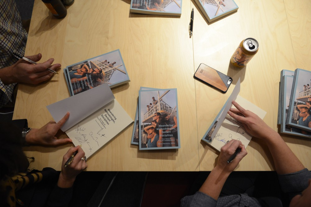 Authors of Meandering Methodologies, Deviant Disciplines - Four Years of City Art Collaboratory sign their book at Public Art Saint Paul on Oct. 6, 2016.