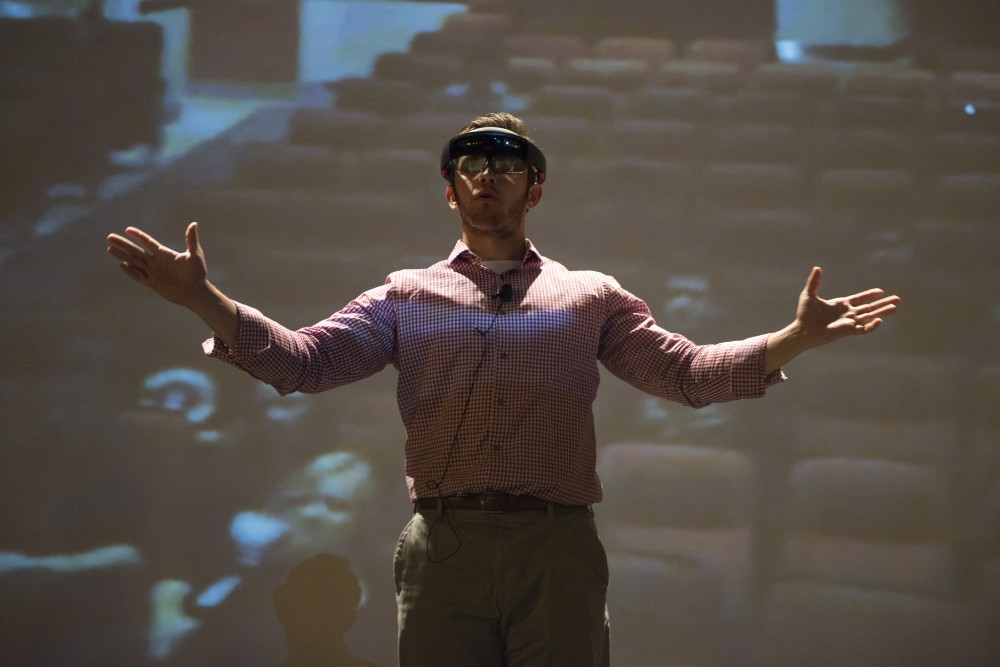 Brandon Bogdalek, officer of the University's Augmented Reality Collective, demonstrates how to use a HoloLens, an augmented reality device, at the group's meeting in the Coffman Memorial Union Theater on Oct. 9, 2016. The device is one of a few devices the group works with.