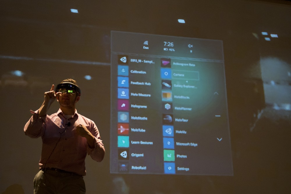 Brandon Bogdalek, officer of the Universitys Augmented Reality Collective, demonstrates how to use a HoloLens, an augmented reality device, at the groups meeting in the Coffman Memorial Union Theater on Oct. 9, 2016. The device is one of a few devices the group works with.