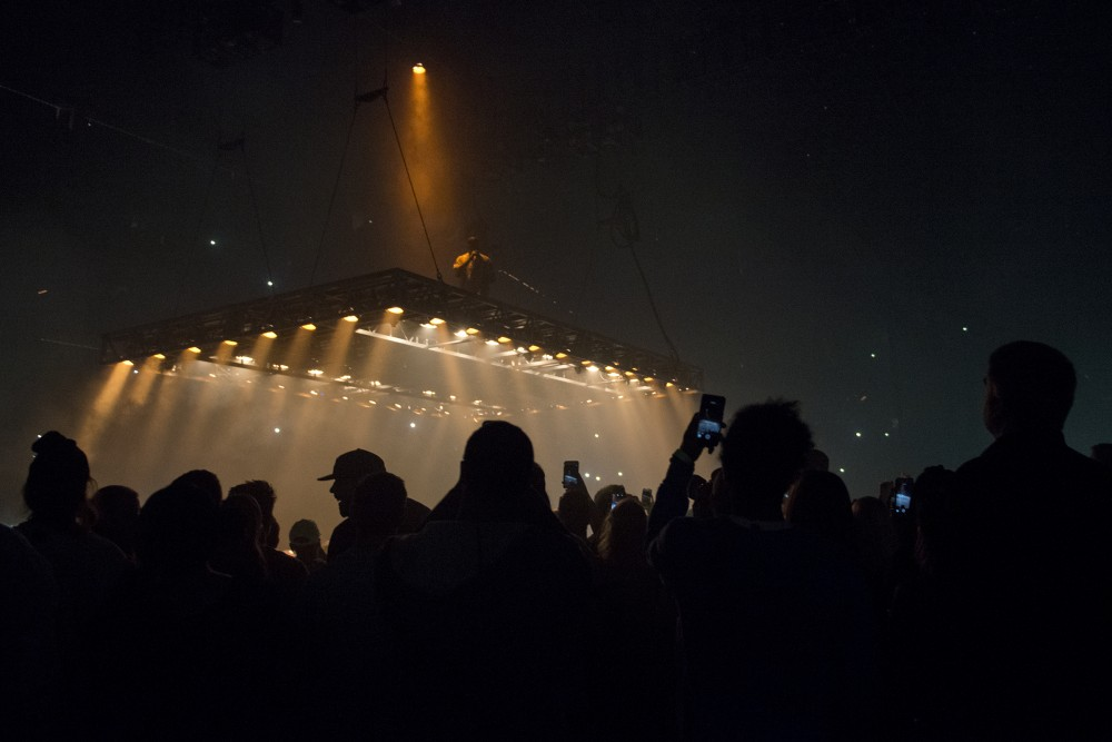 Kanye West performs atop a stage suspended above the general admission crowd for his St. Paul stop of The Saint Pablo Tour at the Xcel Energy Center on Monday, Oct. 10, 2016.