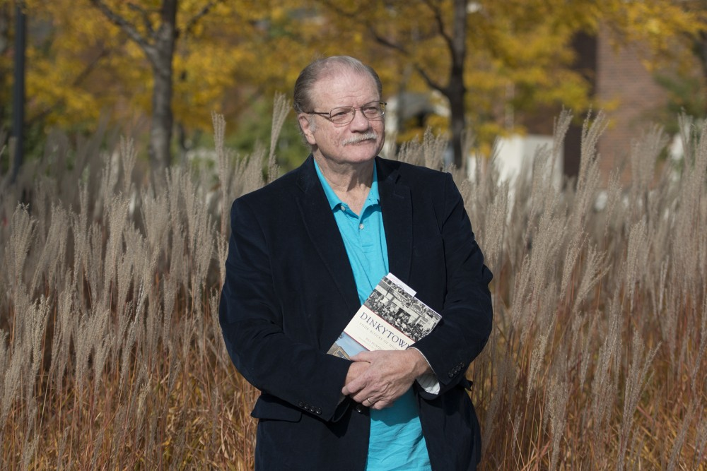 Journalist and author Bill Huntzicker poses with his newly released book,