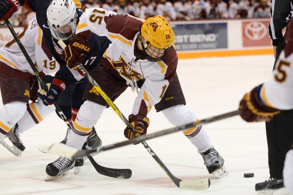 Gophers forward Rem Pitluck fights for the puck on Friday, Oct. 14, 2016 at Mariucci Arena.