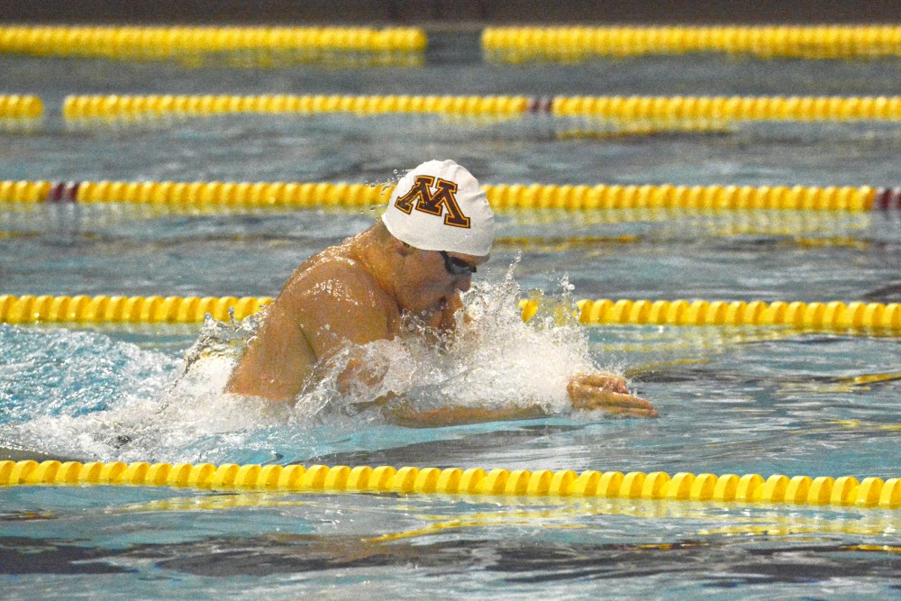 Junior Connor McHugh swimming the men's 200 meter breaststroke at the Gophers' first meet of the season against the Wisconsin Badgers at the Jean K. Freeman Aquatics Center on Oct 13. 2016.