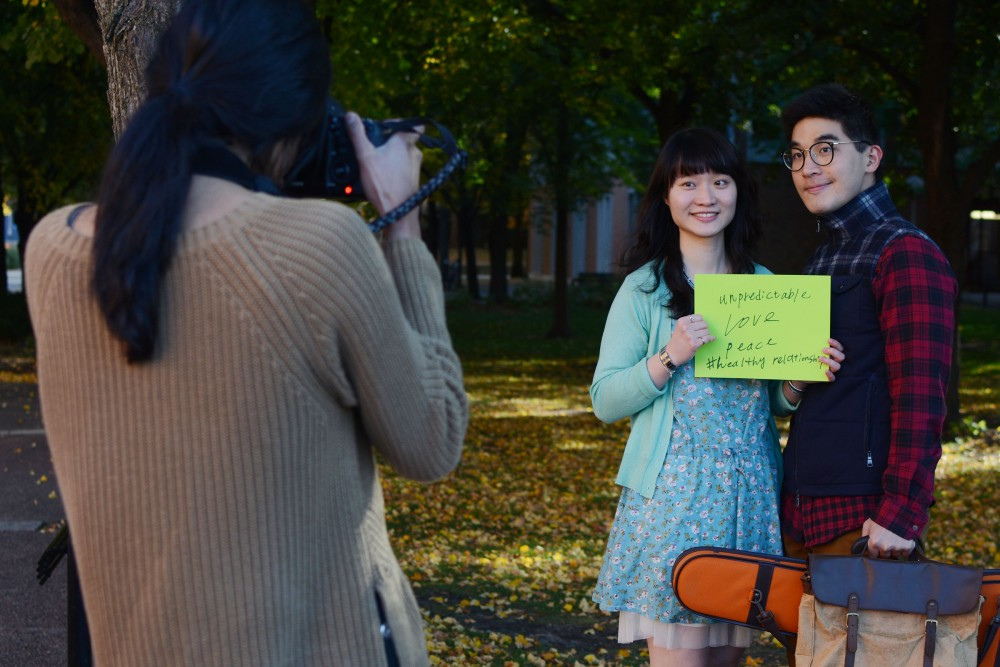 Second year Ph.D. student Nai-Chia Chen and  third year Ph.D. student Hsuan Lin gets their photo taken by sophomore Niti Gupta on Wednesday, Oct. 19, 2016 on West Bank. The Aurora Center's