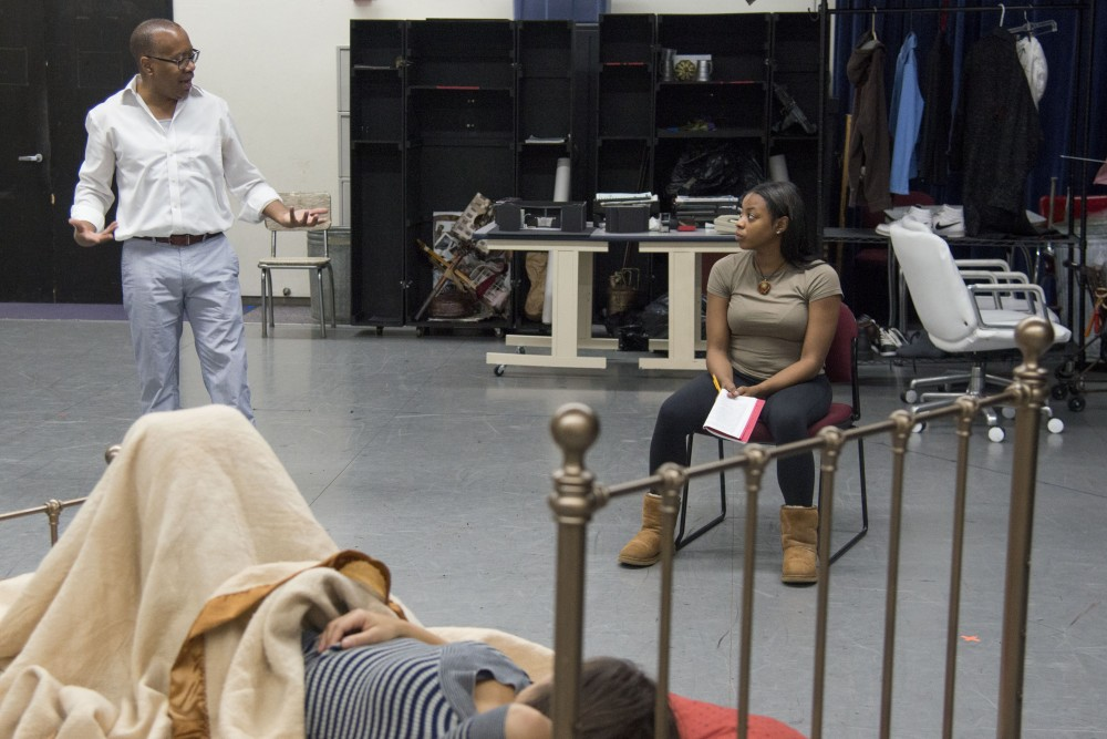 Director Talvin Wilks coaches actor Alyse Brown in a rehearsal for