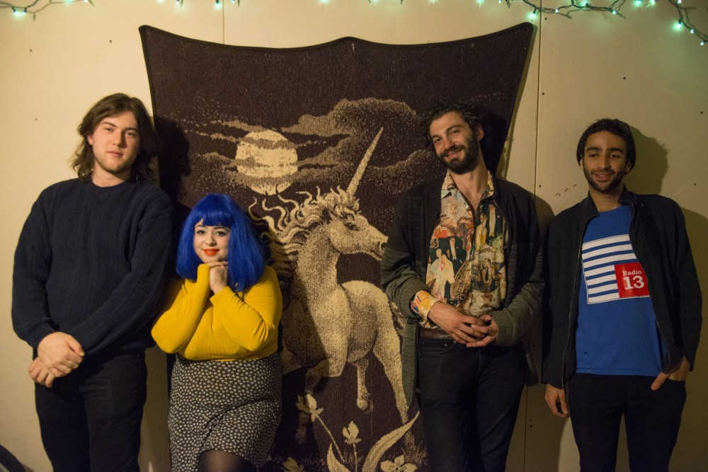 Members of the band Sass, from left to right, Willem Vander Ark, Stephanie Jo Murck, Alex McCormick and Joey Hayes, pose in their practice space in the South East Como neighborhood in Minneapolis.