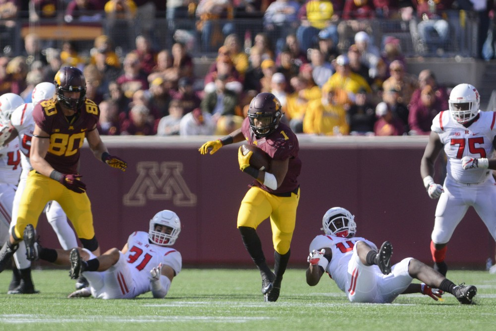 Gophers running back Rodney Smith leaves a trail of Rutgers defenders in his wake on Saturday, Oct. 22, 2016 at TCF Bank Stadium.