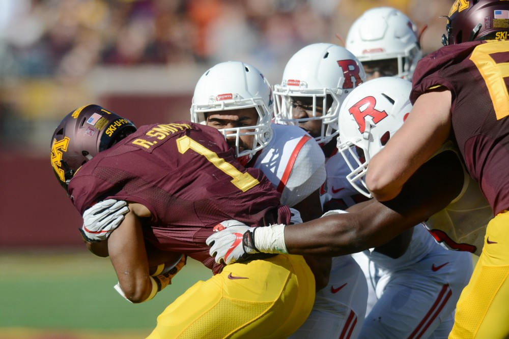 Running back Rodney Smith is tackled on Saturday, Oct. 22, 2016 at TCF Bank Stadium.