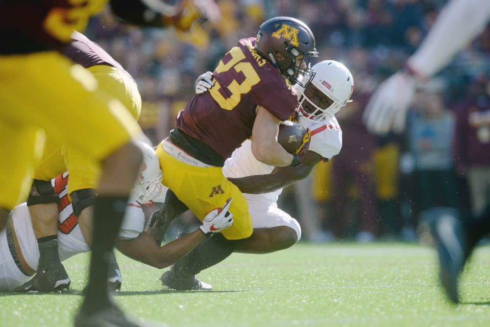Running back Shannon Brooks is tackled on Saturday, Oct. 22, 2016 at TCF Bank Stadium.