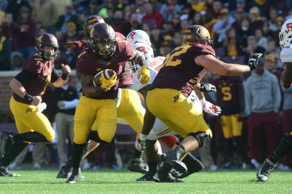 Running back Rodney Smith runs the ball up the field on Saturday, Oct. 22, 2016 at TCF Bank Stadium. The Gophers played against Rutgers University Scarlet Knights at the Gopher's Homecoming game.