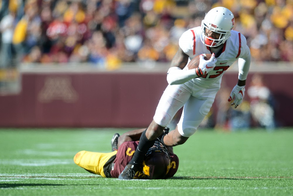 Defensive back Jalen Myrick tackles wide receiver Carlton Agudosi as  he attempts to run on Saturday, Oct. 22, 2016 at TCF Bank Stadium.