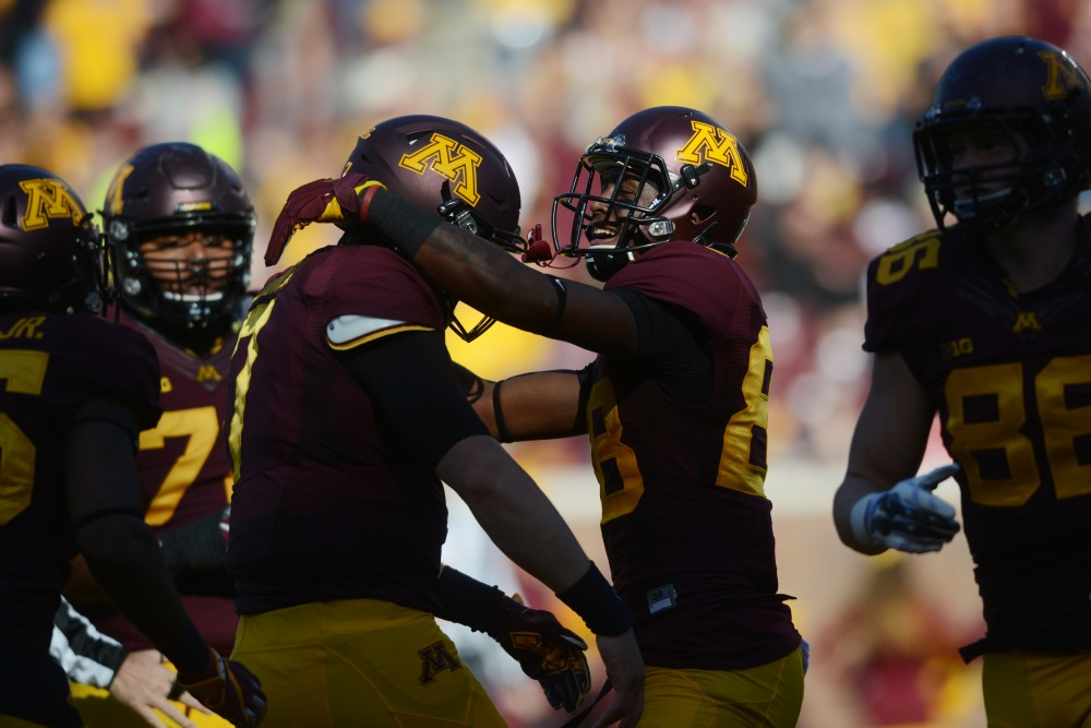 The gophers celebrate after quarterback Mitch Leidner scores a touchdown on Saturday, Oct. 22, 2016 at TCF Bank Stadium.