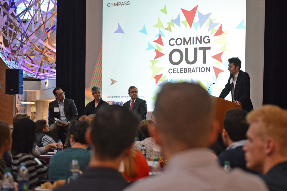 Compass cofounder Nick Alm introduces the speaking panel on Thursday at the Carlson Atrium. Compass is the first LGTBQ+ group formed at Carlson and held a