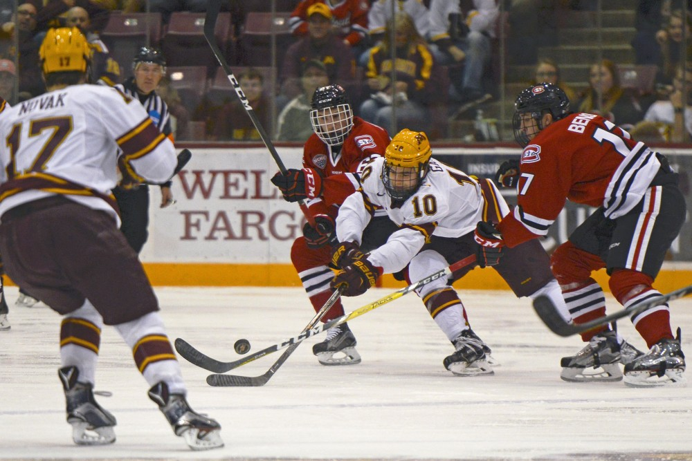 Gophers forward Brent Gates Jr. battles for the puck against St. Cloud State at Mariucci Arena on Oct. 21, 2016.