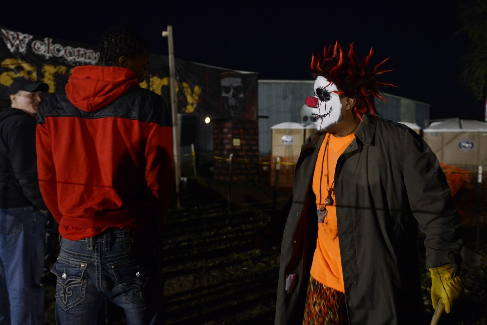 An actor stalks patrons at the Trail of Terror on Sunday, Oct. 23, 2016 in Shakopee, Minnesota. Trail of Terror has multiple Halloween attractions, including a haunted woods walk and a three fourth of a mile haunted maze, Hotel 666.