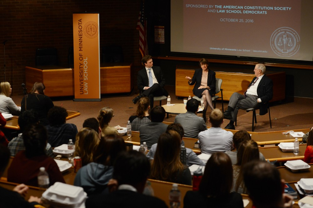 Democratic Sen. Amy Klobuchar, center, speaks to a full lecture hall about the current Supreme Court vacancy on Tuesday, Oct. 25, 2016 on West Bank. President of the Law School Democrats, Seth Zawila, left, moderated the forum with Klobuchar and Former U.S. Vice President Walter F. Mondale, right, about their experiences in the senate with vetting and voting on Supreme Court nominees.