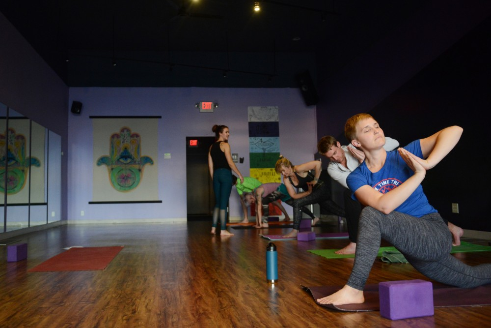 Yoga Sol operations manager Krista Costin practices yoga at a vinyasa class on Monday, Oct. 24, 2016 at Yoga Sol in Northeast Minneapolis.