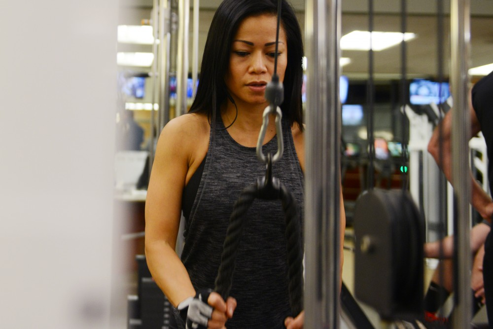 "Cookie Francisco works out at Life Time Athletic on Tuesday in Eden Prairie. Francisco is the 2016 Minnesota State and North Star Masters Bikini Overall Champion. She dedicated 5 months to get ready for the show in June, saying ""prepping is all about discipline."""