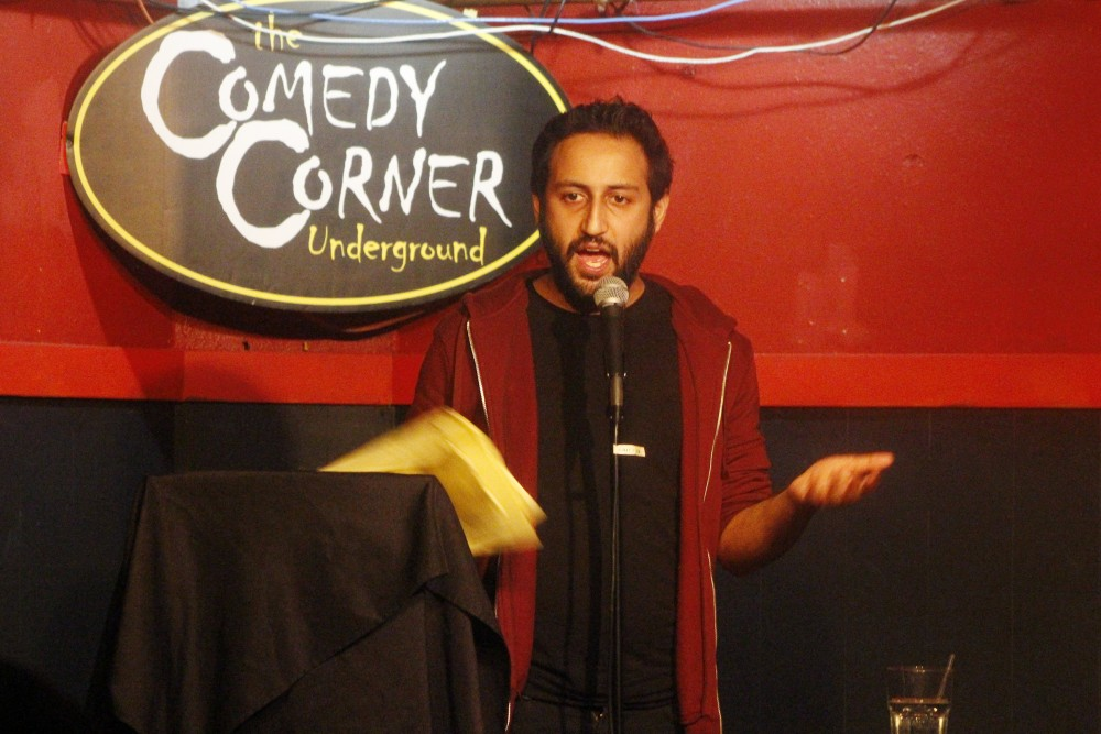Comedian Raghav Mehta preforms at The Comedy Corner Underground in Minneapolis on Tuesday, at a roast he put together for himself as a farewell before he leaves for New York City.