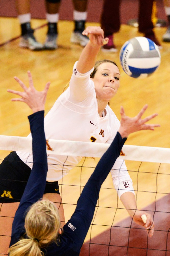 Middle blocker Hannah Tapp spikes the ball against Penn State in the Sports Pavilion on Nov. 14, 2015.