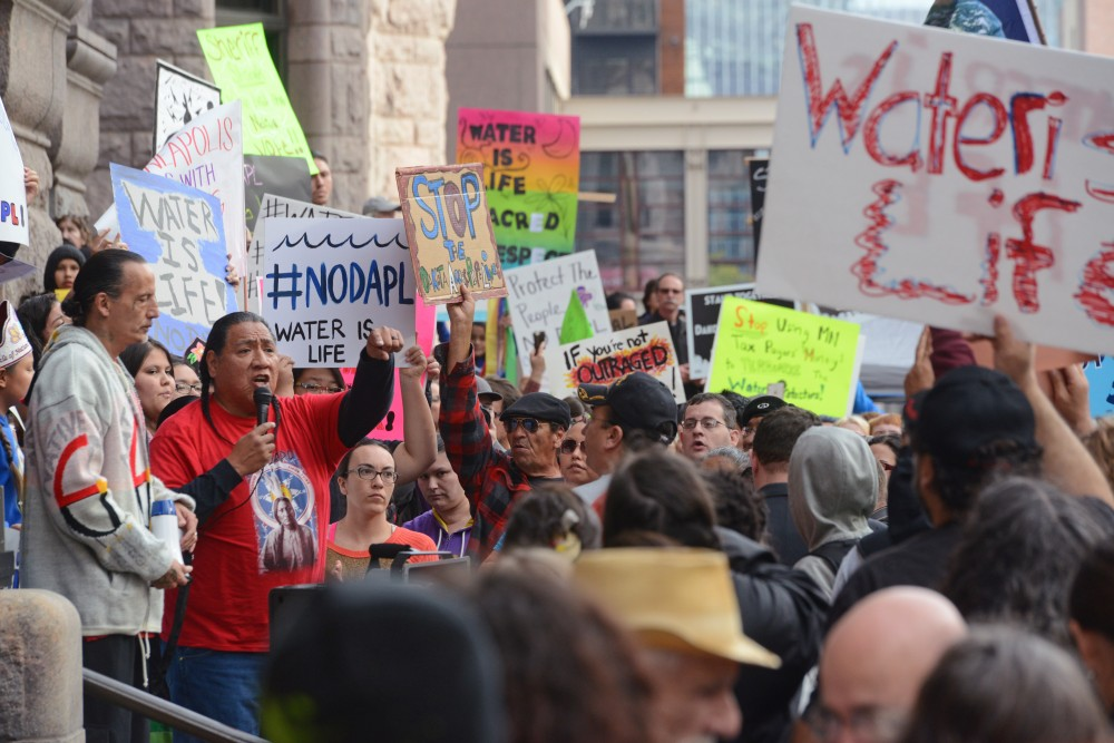Protesters gather outside Minneapolis City Hall on Friday Oct. 28, 2016. Protestors rallied together to show their opposition to the Dakota Access Pipeline and the Hennepin County Sheriff's deputies participation in dispersing protesters.