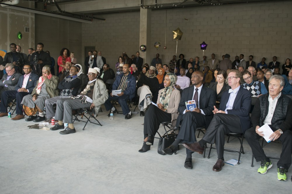 Attendees of the groundbreaking event for the Cedar Riverside Opportunity Center listen to speakers on Oct. 29, 2016. The center will work to help community members, many of whom are East African immigrants, find jobs.