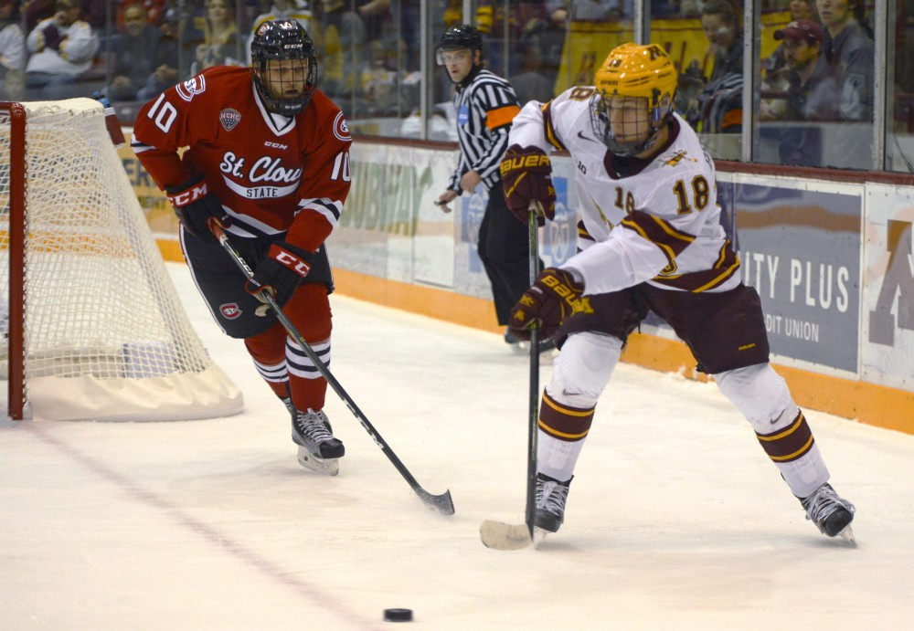 Gophers forward Leon Bristedt passes the puck at Mariucci Arena on Oct. 21, 2016.