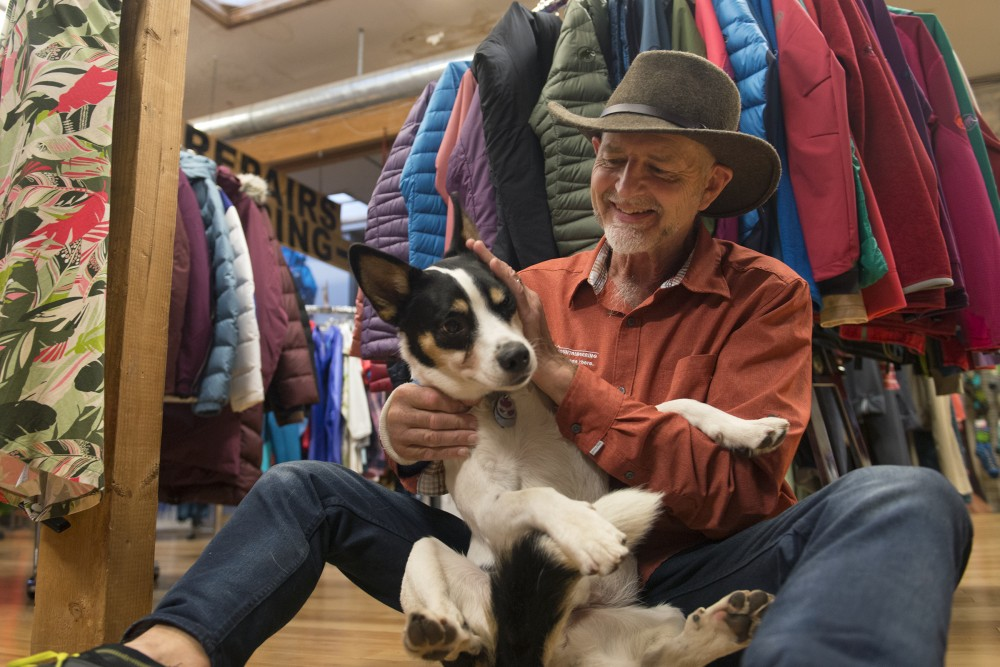 Midwest Mountaineering founder and owner Rod Johnson and his 4-year-old rescue dog Finney pose for a portrait in his store on Wednesday, Oct. 26, 2016 on West Bank. Johnson started his business in 1970 to get climbing gear at wholesale and began selling out of his kitchen for the first 6 months. After that, he opened a store on Hennepin Avenue and in 1976, moved to the current West Bank location.