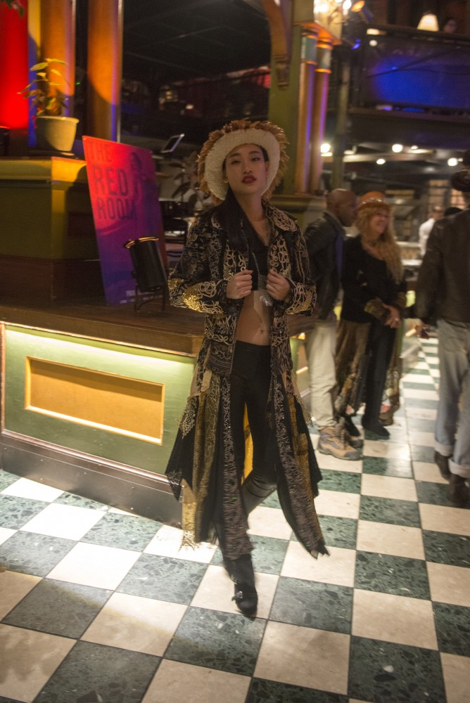 A model wearing designer Shelley Wades clothing poses during Wades show at the Loring Pasta Bar on Oct. 30, 2016. Wades creations have a Gypsy influence and were originally intended to be shown to Prince in a private show.