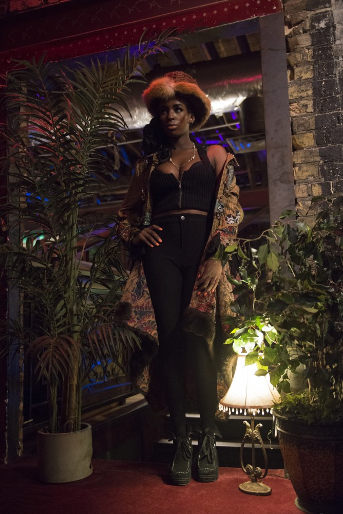 A model wearing designer Shelley Wades clothing poses before Wades show at the Loring Pasta Bar on Oct. 30, 2016. Wades creations have a Gypsy influence and were originally intended to be shown to Prince in a private show.