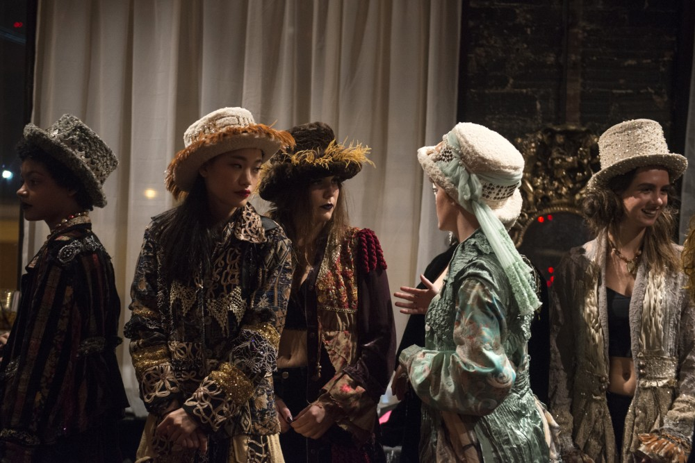 Models wait backstage before walking in designer Shelley Wades show at the Loring Pasta Bar on Oct. 30, 2016. Wades creations have a Gypsy influence and were originally intended to be shown to Prince in a private show.