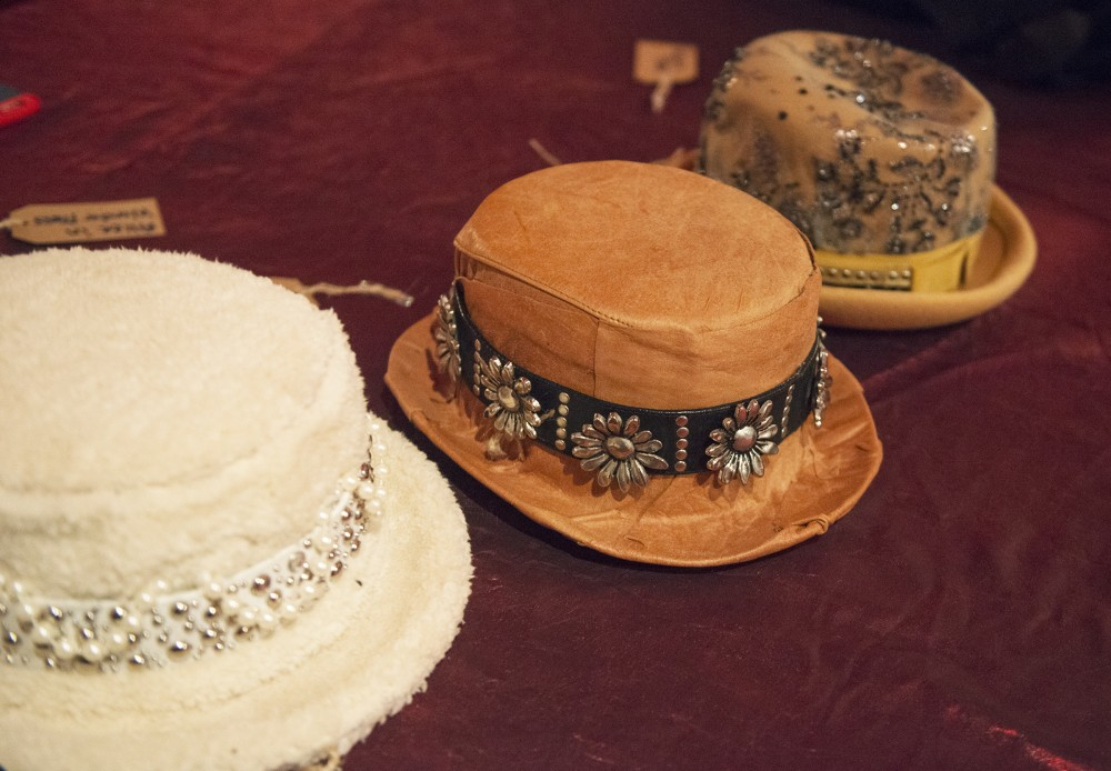 Some of designer Shelley Wades hats sit on a table backstage before her show at the Loring Pasta Bar on Oct. 30, 2016. Wades creations have a Gypsy influence and were originally intended to be shown to Prince in a private show.