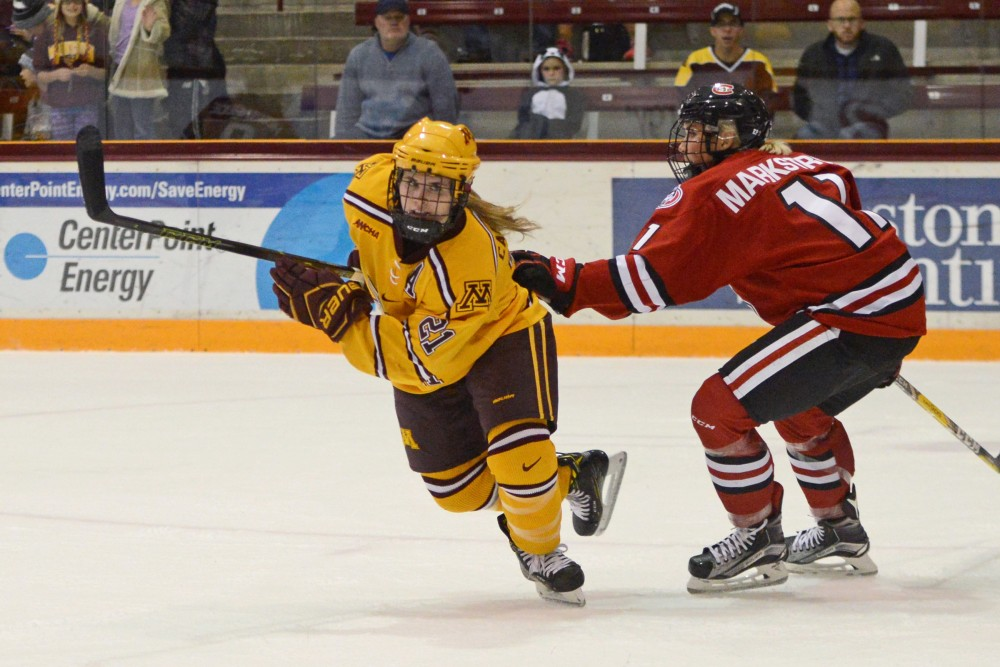 Senior forward Dani Camaranessi races after the puck at Ridder Arena on Oct. 29, 2016, where the Gophers beat St. Cloud State 3-0. Camaranessi scored two of the Gophers three goals.