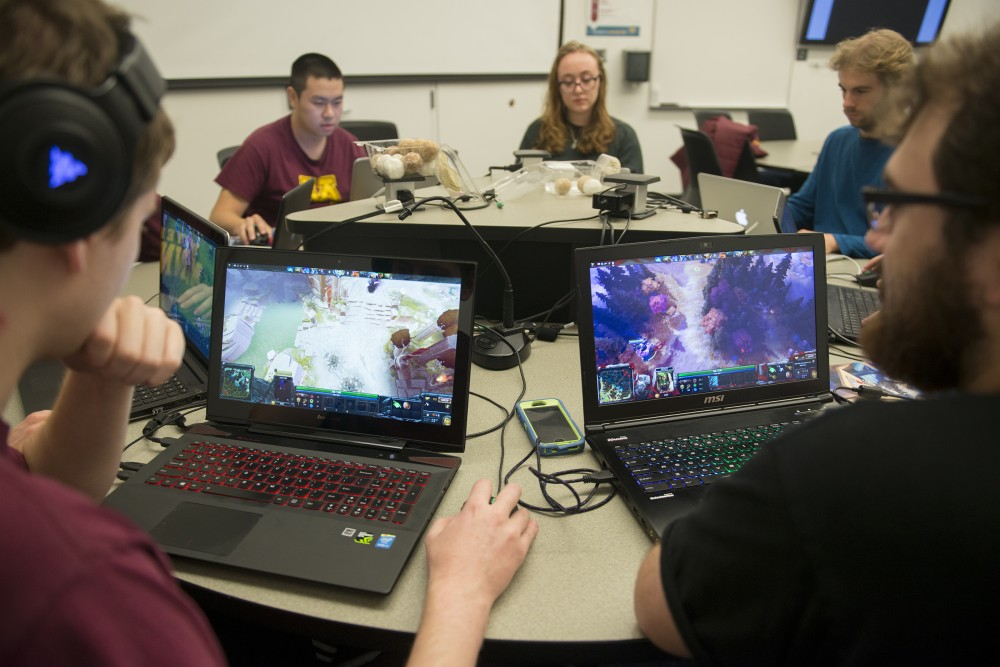 History juniors Nick Carrigan, left, and Ian Lambert, right, play Dota 2 on Wednesday, Oct. 26, 2016 at Bruininks Hall on East Bank with the uDota club during its weekly meeting.