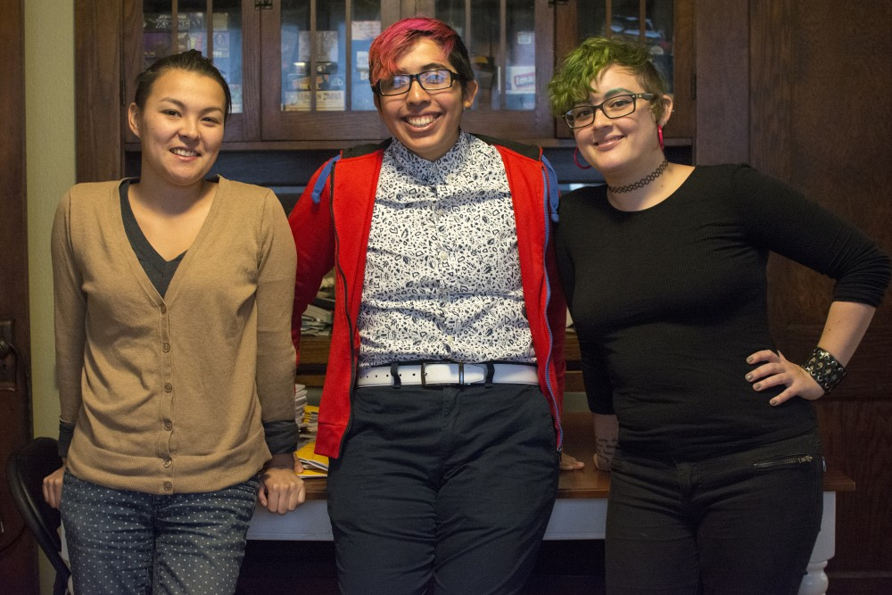 Plus Dog Collective members April Kasulis, left, Alex Araiza, center, and Marissa Luna, right, pose for a portrait on Monday, Oct. 31, 2016 in Minneapolis. They will attend Short  Run Seattle, a comix and art festival, next weekend to promote Plus Dog Collective and connect with other artists.