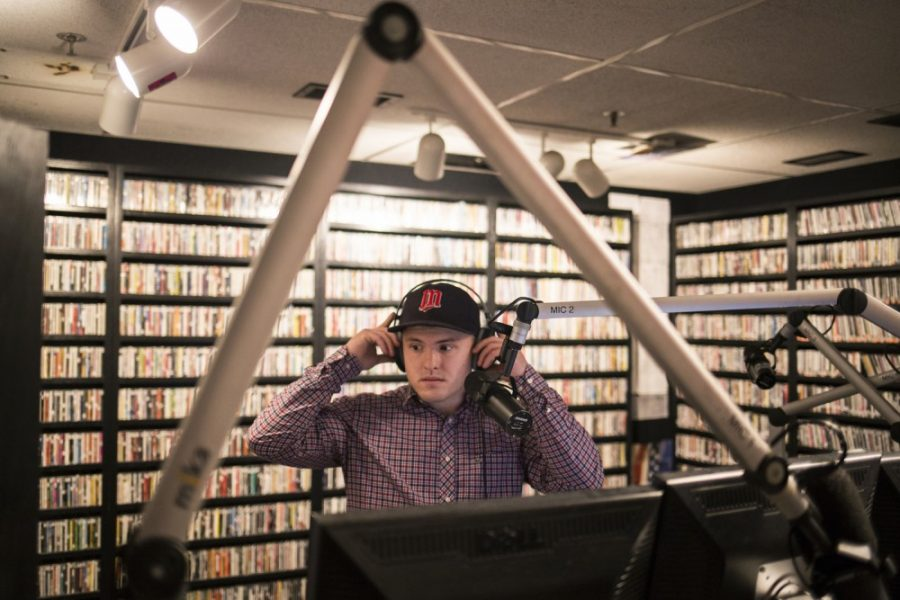 Senior Teddy Skillings prepares to go live during a late-night shift at Radio K on Friday, Feb. 5. Assuming the name