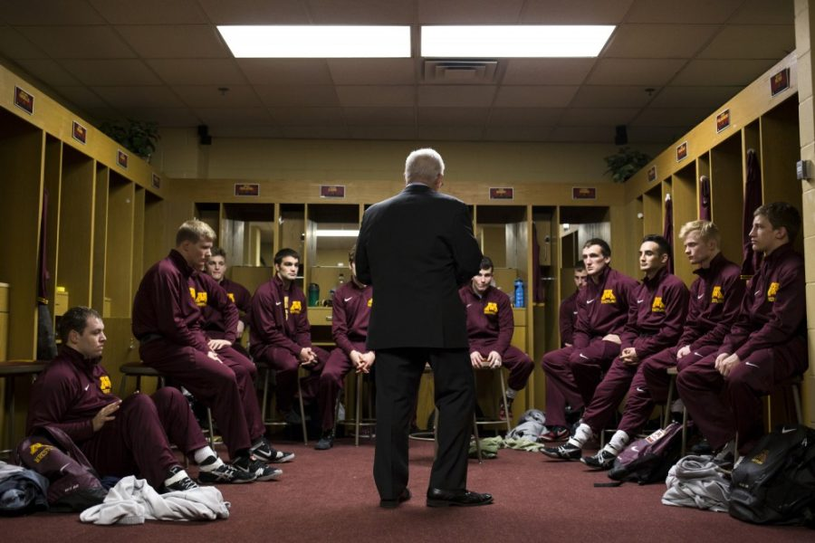 Head Coach J Robinson delivers a speech to the wrestling team, minutes before the start of their home dual at the Sports Pavilion. A 1972 Olympian himself, Robinson has lead the Gophers wrestling team for thirty years.