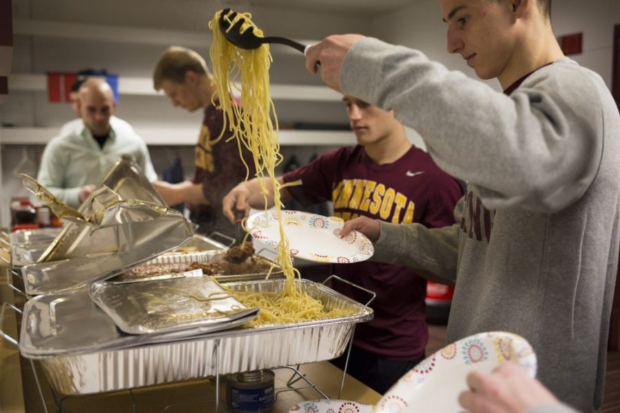 Immediately following their weigh-in, the wrestling team enjoys a hot meal to fuel them through their dual meet, less than one hour away.