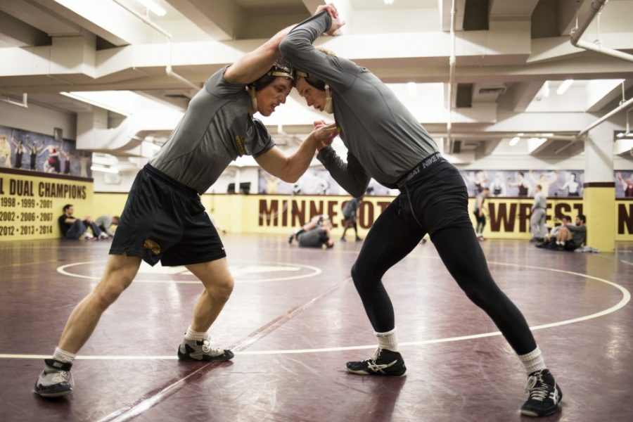 During a post-practice sparring match, redshirt freshman Skyler Petry, left, and junior Sam Brancale wrestle