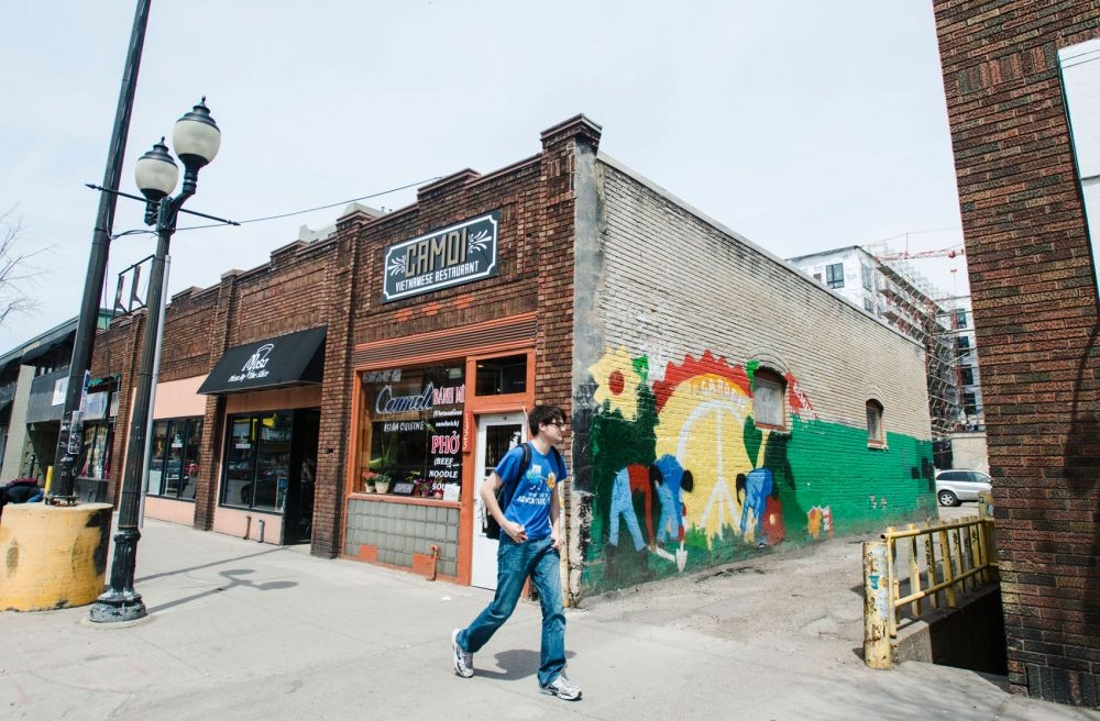 A person walks in Dinkytown on May 8, 2014.