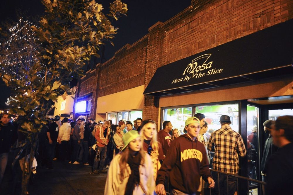 Late-night crowds line up for a slice of Mesa Pizza during homecoming weekend Oct. 14, 2012, in Dinkytown.