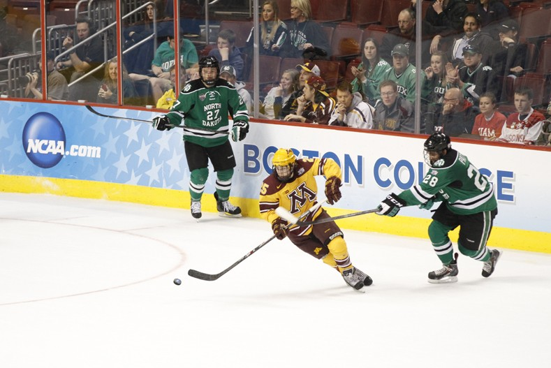 Gophers forward Justin Kloos carries the puck during the Frozen Four semifinal on April 10, 2014 at Wells Fargo Center in Philadelphia. Minnesota defeated North Dakota 2-1.