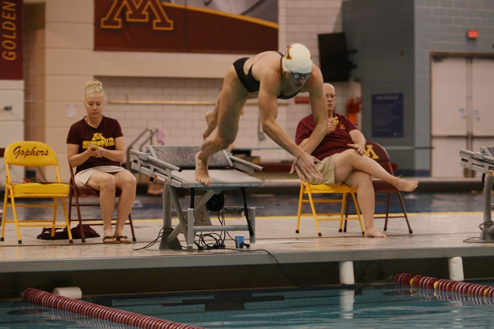 Freshman Lindsey Horjesi participates in the 50 meter freestyle event at the women's swim and dive meet against Iowa State at the Jean K. Freeman Aquatic Center on Oct. 30, 2016.