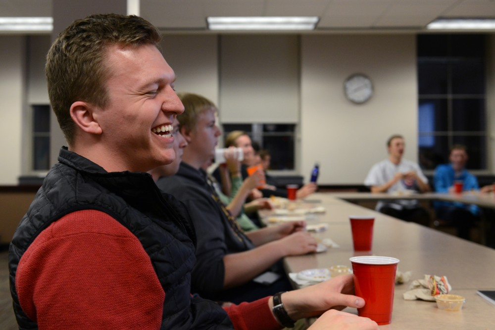 """Political science senior Levi Carstensen laughs at a joke while waiting for the """"Roast of Trump, Clinton, Aleppo, and this Awful Election"""" to begin on Tuesday, Nov. 1, 2016 at Coffman. Young Americans for Liberty hosted a political roast to poke fun at national political candidates before the election."""