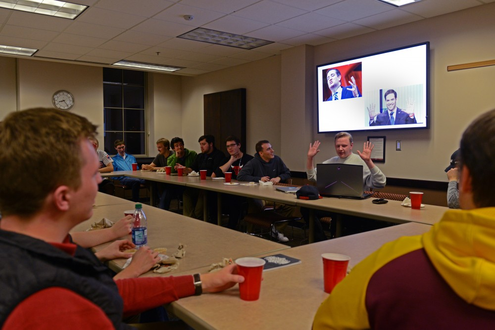 """Young Americans for Liberty general officer Chaz Fenske tells jokes at """"The Roast of Trump, Clinton, Aleppo, and this Awful Election"""" on Tuesday, Nov. 1, 2016 at Coffman. Young Americans for Liberty hosted a political roast to poke fun at national political candidates before the election."""